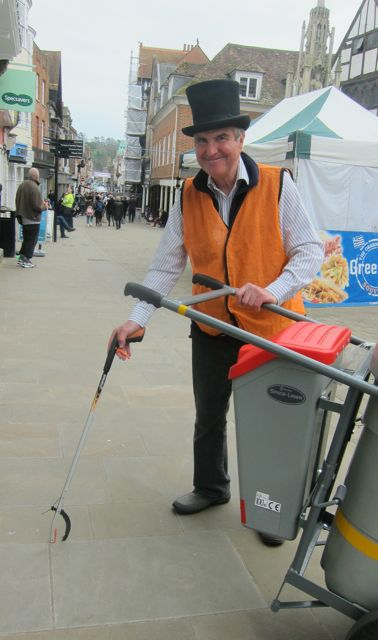 Terry picking up litter in Winchester with litter picker. I met Terry in Winchester city centre. He told me he enjoyed picking up litter and greeting visitors.