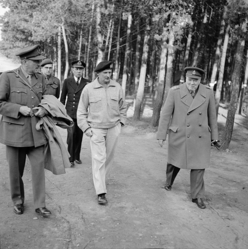 Winston Churchill with Field Marshal Sir Bernard Montgomery and Field Marshal Sir Alan Brooke during the Prime Minister's tour of troops taking part in the Rhine crossing, 25 March 1945. © IWM (BU 2263)