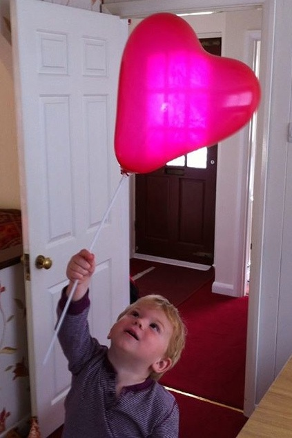 Tom with red balloon