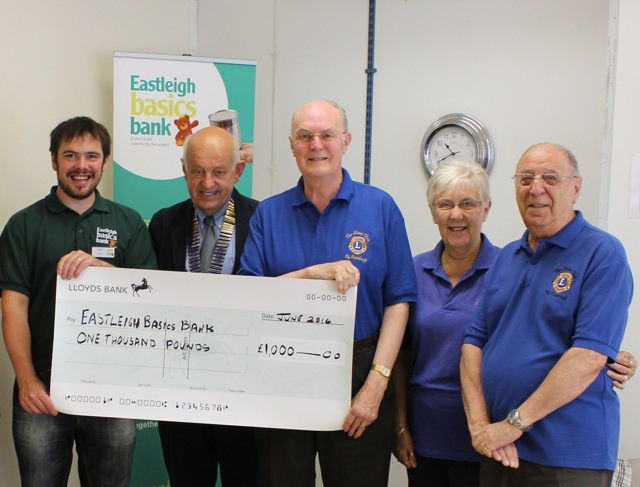 Eastleigh Lions Club President Philip Spearey handed a £1,000 donation to Eastleigh Basics Bank.