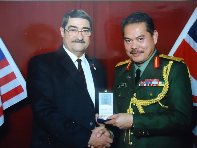 Jeff: Receiving my Pingat Jasa Malaysia (PJM) medal from Brigadier General Othman bin Jamal, in 2010.