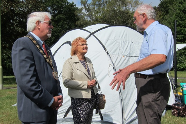 Tony Trowsdale (right) from ShelterBox explained to Mayor of Eastleigh Councillor Tony Noyce and Mayoress Janice Noyce about ShelterBox.