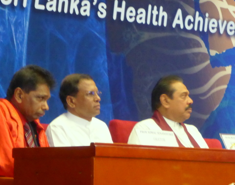 Now the UK-trained doctor (in red doctorate gown) in Sri Lanka is famous and he shares platform with the President of Sri Lanka.