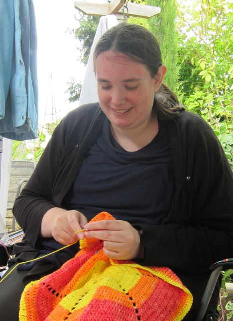 Rachel Potter crocheting at Brambridge Park garden.