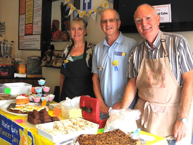 Fundraising for Marie Curie Cancer Care at Asante. Ray Fishman (centre) with Shirley and Paul Barter, the proprietors of Asante.