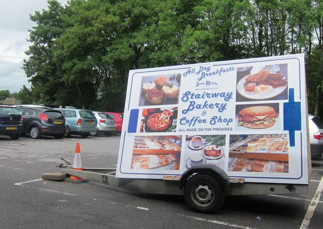 Stairway Bakery advert on a trailer at the Fryern Arcade carpark.