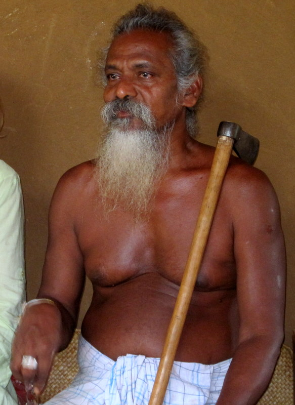 The Chief of the Vedda. The axe is a symbol of office.