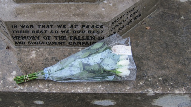 White roses placed at Chandler's Ford War Memorial.