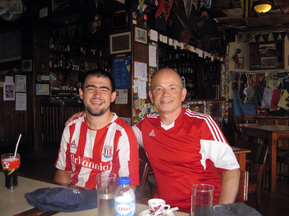 Stoke City fan James (left) shares a drink with Andy in Horta.