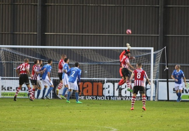 Eastleigh keeper Ross Flitney under pressure from Lincoln Citys No 5 Hamza Bencherif.
