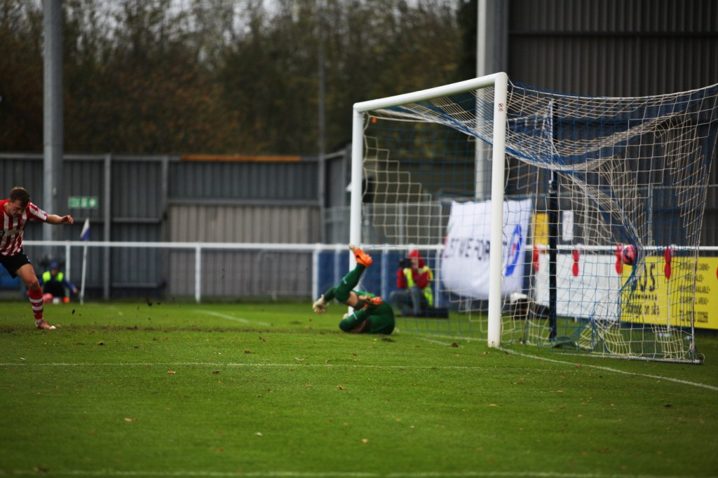 GOAL Craig McAllister's header bulges the back of the net for Eastleigh's opener.