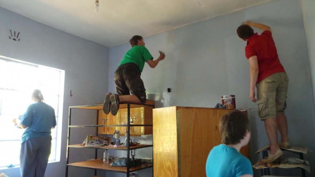 The team painting rooms at the clinic in their last trip.