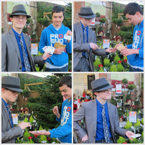 Magic Ed (left) performing card tricks to Ben outside Brambridge Park Garden Centre today.