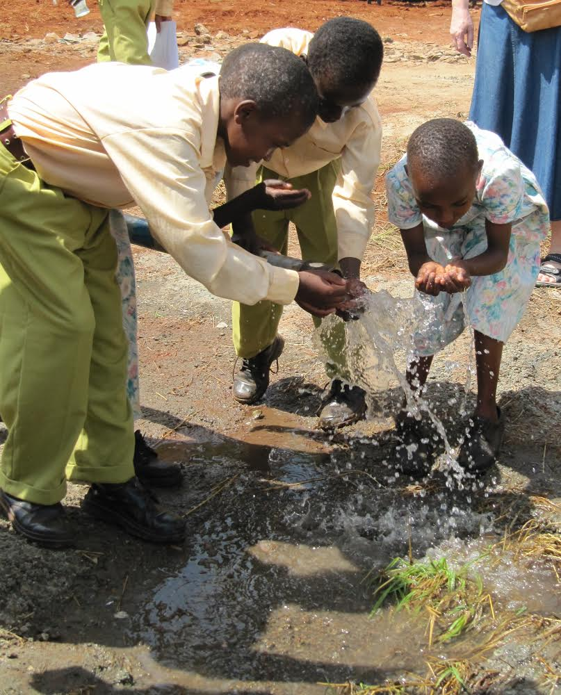 St Stephen's children in Embu in Kenya sampling the water from the bore hole.