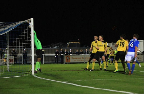 Jamie Collins sees his header saved by the Dartford keeper Jason Brown.