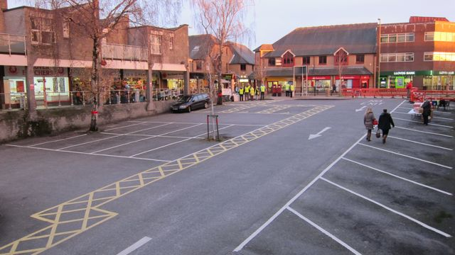 Quiet Fryern Arcade car park before carol singing started.