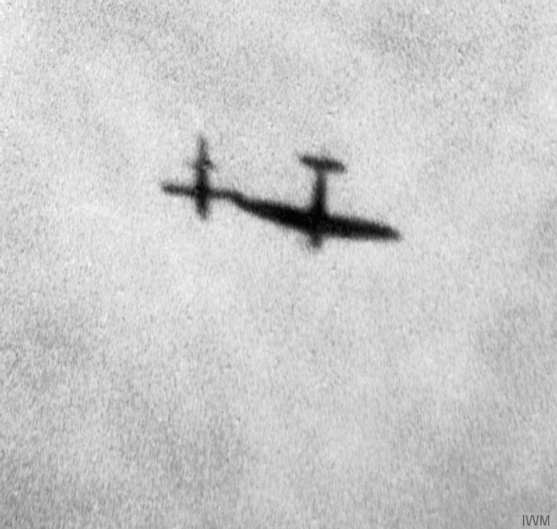 "Seen in silhouette, a Supermarine Spitfire manoeuvres alongside a flying bomb in an attempt to deflect it from its target. © IWM <a href=""http://www.iwm.org.uk/collections/item/object/205022387"">V1 FLYING BOMB (CH 16281)</a>."