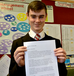 Proud Brandon Hulcoop showing his winning essay.