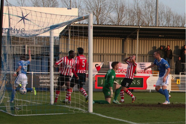 Eastleigh's No 12 Jack Midson peels away after opening the scoring.
