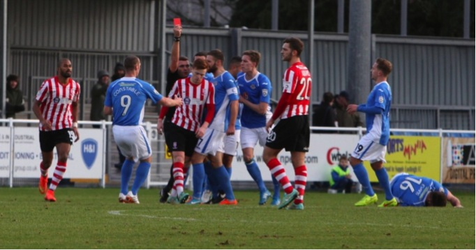 Lincoln City's Joe Nolan sees red.