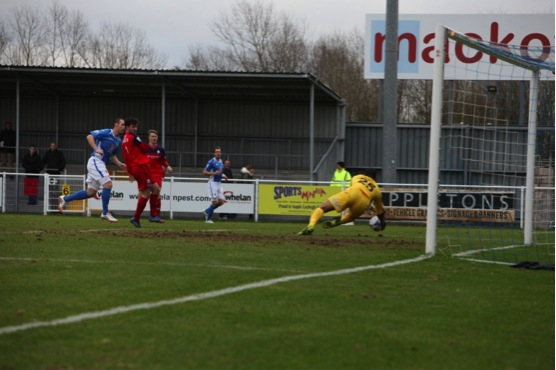 James Constable brings a save from Telfords keeper Freddy Hall.