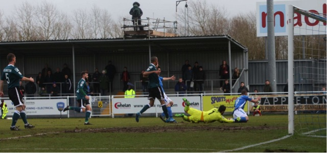 James Constable goes down in the box but the referee waves play on. Eastleigh 4 Macclesfield Town 0; 12:45 Saturday February 28th 2015