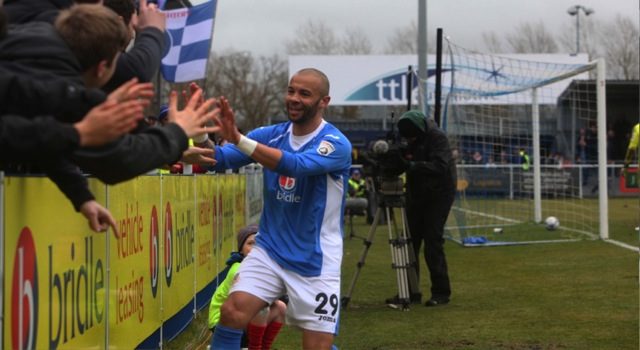 Dean Burton has made it 4-0 to The Spitfires and celebrates with the crowd. Eastleigh 4 Macclesfield Town 0; 12:45 Saturday February 28th 2015