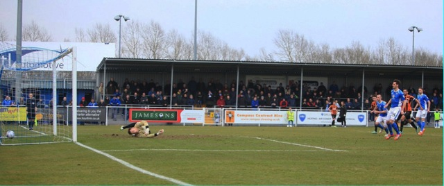 Ben Strevens pulls one back for Eastleigh from the penalty spot.