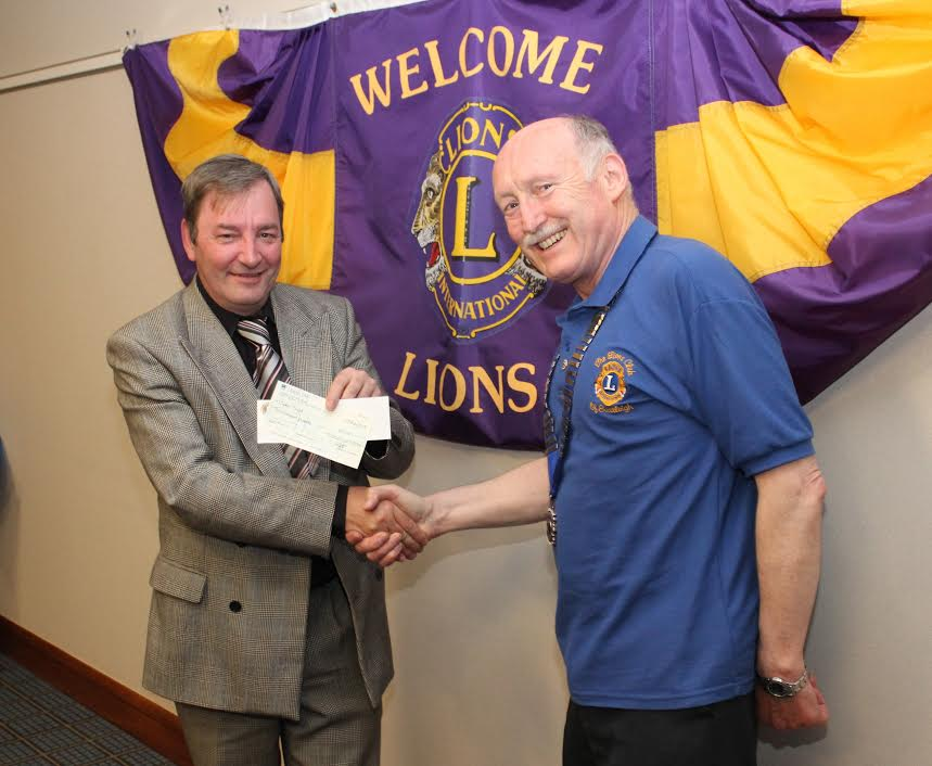 Contributions from Lions Club of Eastleigh to the charity Open Sight in 2013. Right: Dave Bowring.