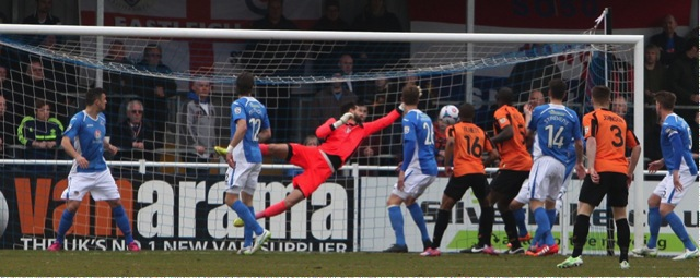 Eastleigh keeper Ross Flitney palms the ball away.