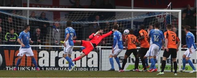 Eastleigh keeper Ross Flitney palms the ball away.