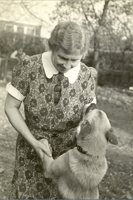 "Helen Keller with her Akita dog, Kamikaze. Image by <a href=""http://en.wikipedia.org/wiki/File:Keller_and_Her_Dog,_Kamikaze.jpg"">Perkins School for the Blind Archives</a> via Wikimedia Commons."