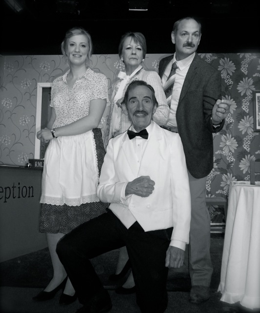 Fawlty Towers: Basil Fawlty (Dave Wilkins), Sybil (Marilyn Dunbar), Polly (Lisa Dunbar), and Manuel (Terry James).
