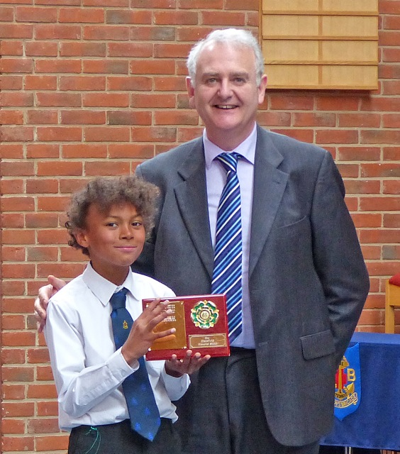 Member of Chandler's Ford Boys' Brigade Brass Band with Adjudicator Donald Lloyd.