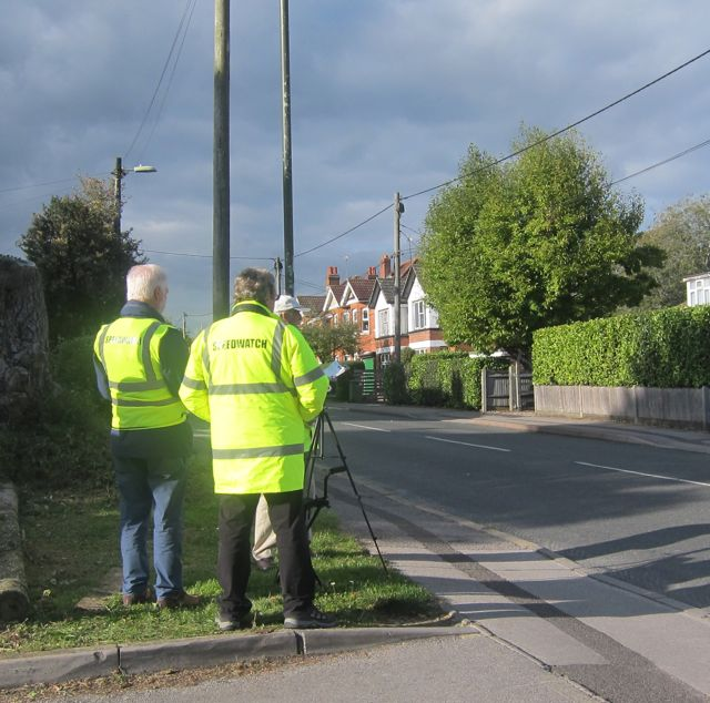 Speedwatch volunteers are seen monitoring the traffic on Hursley Road, Chandler's Ford.