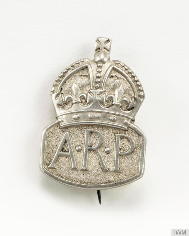 "Badge - Air Raid Precautions <a href=""http://iwm.org.uk/collections/item/object/30071326""> © IWM (INS 4782)</a>"
