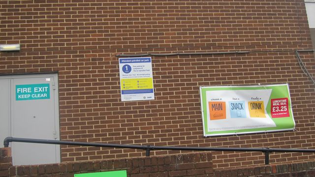 Co-Op parking sign on wall Chandler's Ford