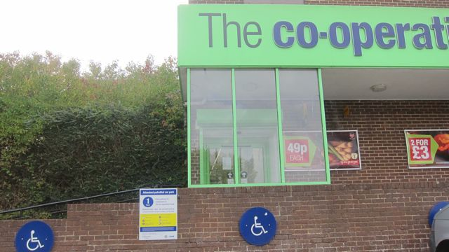 Co-Op parking sign on wall