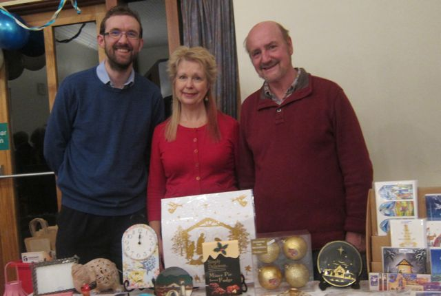 Minister of Velmore Church Bob Dibb (right), with wife Heather, and Jonathan, at Fairtrade evening in Chandler's Ford.