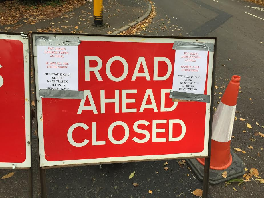 Road Closure sign shops open