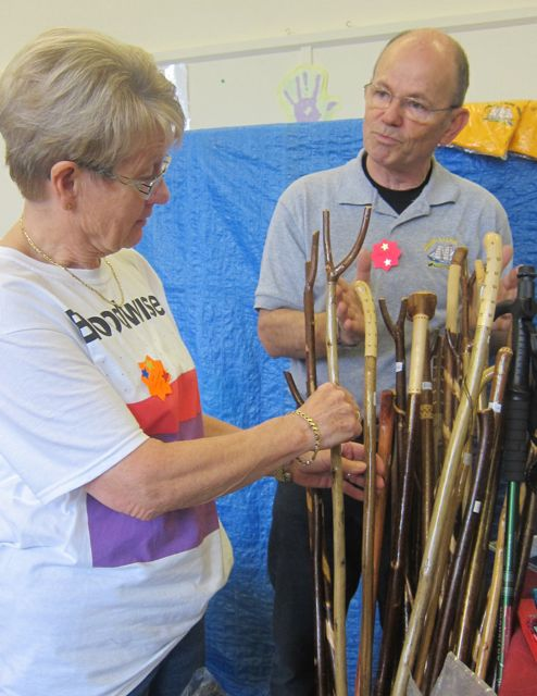 Andy Milner selling walking sticks in aid of Jubilee Sailing Trust.