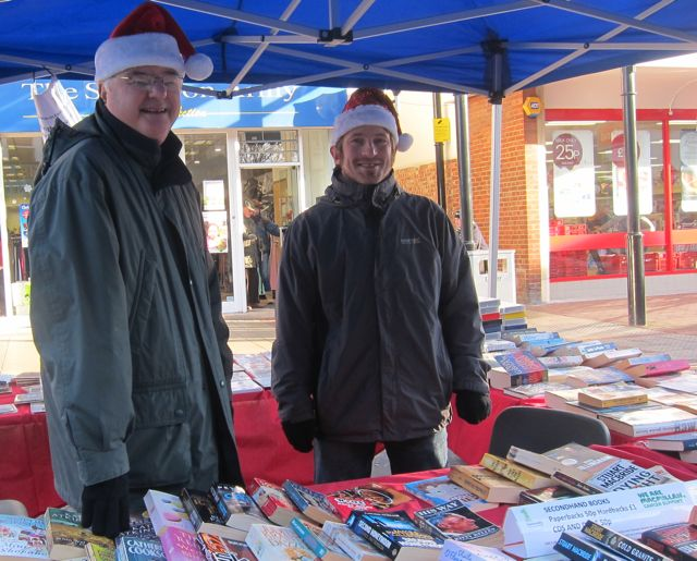 One Community - selling books supporting Macmillan Cancer Trust. Eastleigh Christmas Market Nov 2015