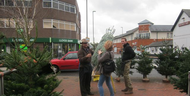 A happy customer just bought a Christmas tree at the Fryern Arcade.