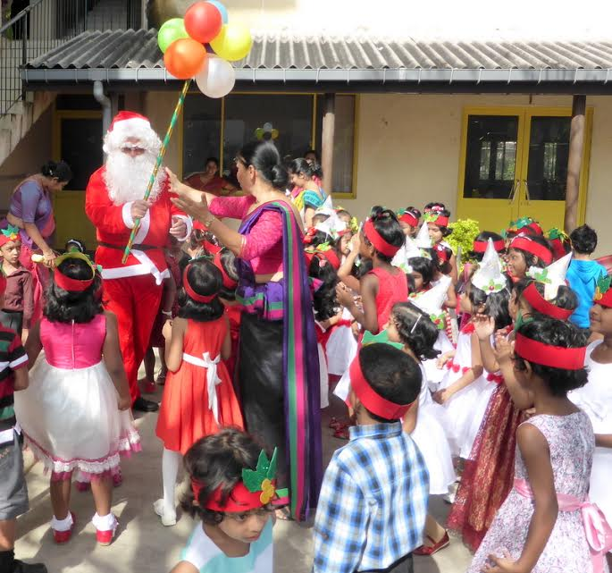 Mike Sedgwick: Dressing up as Santa to entertain children in Sri Lanka.