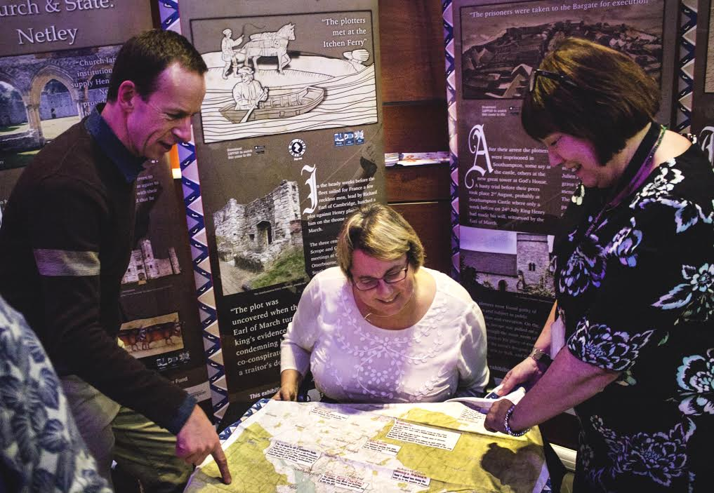 From left to right: SplashMaps' David Overton, Agincourt600 Charity Trustee and Dean of the Faculty of Humanities at the University of Southampton Professor Anne Curry and Eastleigh Borough Council Head of Culture Dr Cheryl Butler examine a SplashMap of Hampshire.