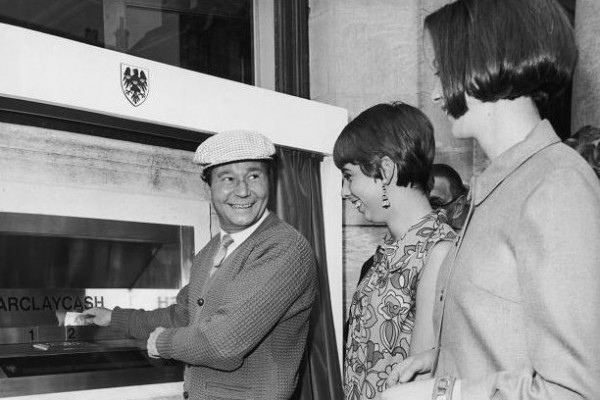 "Reg (On The Buses) Varney using a Cash Point-Machine (Barclaycash). Image by <a href=""https://www.flickr.com/photos/rossendalewadey/11072252125/"">Robert Wade</a> via Flickr."