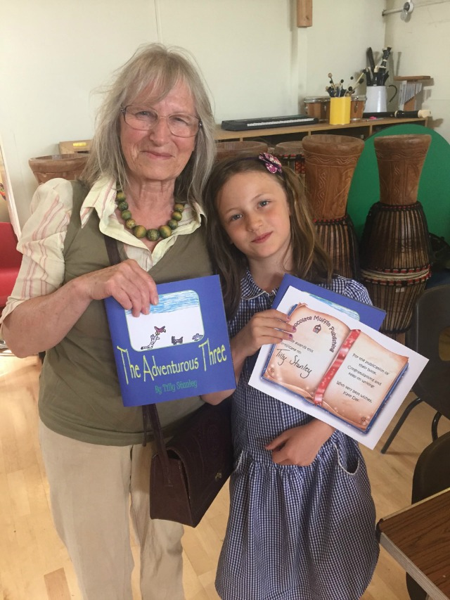 Tilly (with proud grandmother), another of Chocolate Muffin Publishing's proud authors, shows off her work - Image supplied by Kate Day