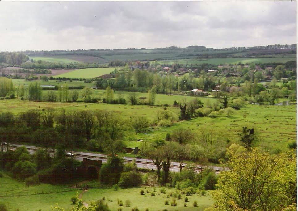 Looking across the water meadows from St. Catherine's Hill, with a curiously quiet A33 in the foreground. The M3 now runs on the other side of the hill and the original road has been filled in to seamlessly join the hillside with the water meadows.