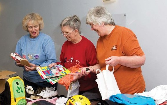Volunteers from Chandler's Ford sorting and packing parcels for Liuli Hospital.