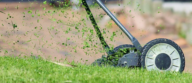 lawn mower, Image by Counselling via Pixabay. A large lawn mower is seen cutting grass.